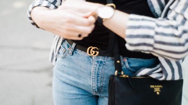 A woman with a black Prada bag