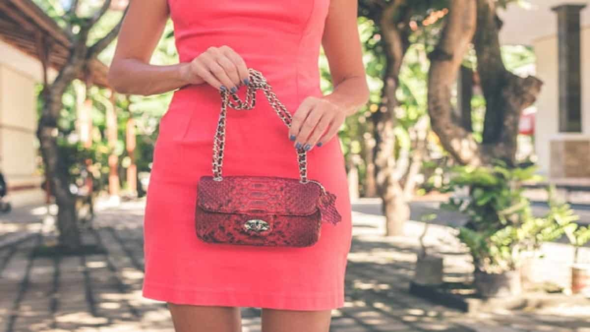 Red handbag with a matching chain and strap
